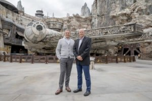 Bob Chapek and Bob Iger stand by the Millenium Falcon at Disney park