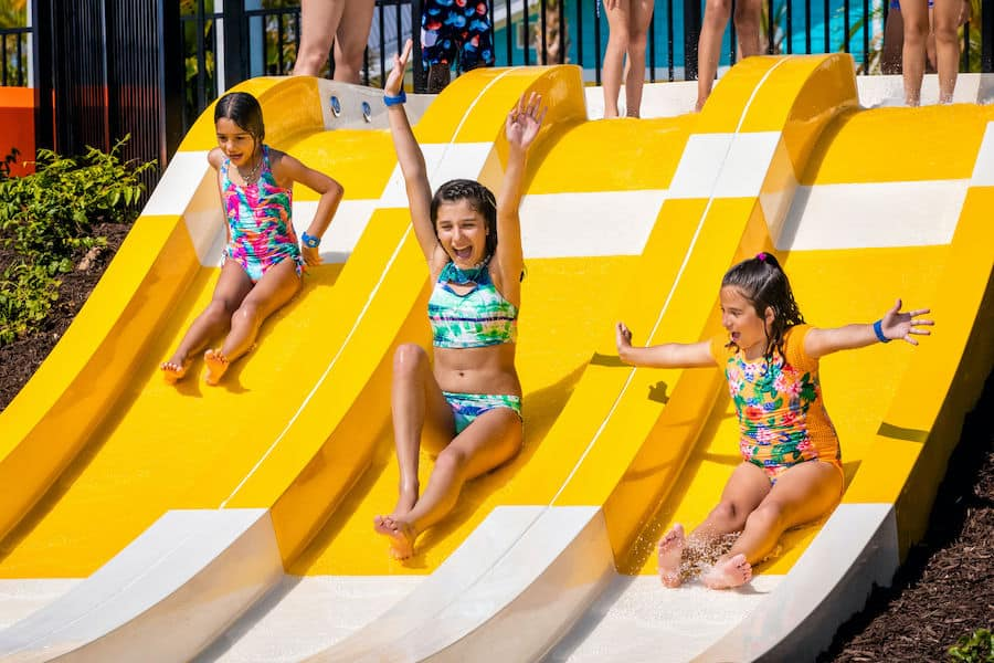 kids playing on the Candy Stripe slides at Island H2O Live