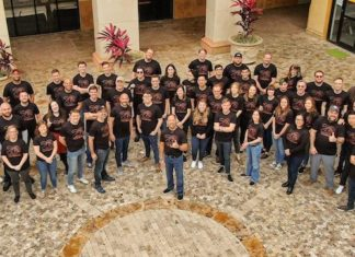 group shot of employees celebrating 20 years of Falcon's Creative Group