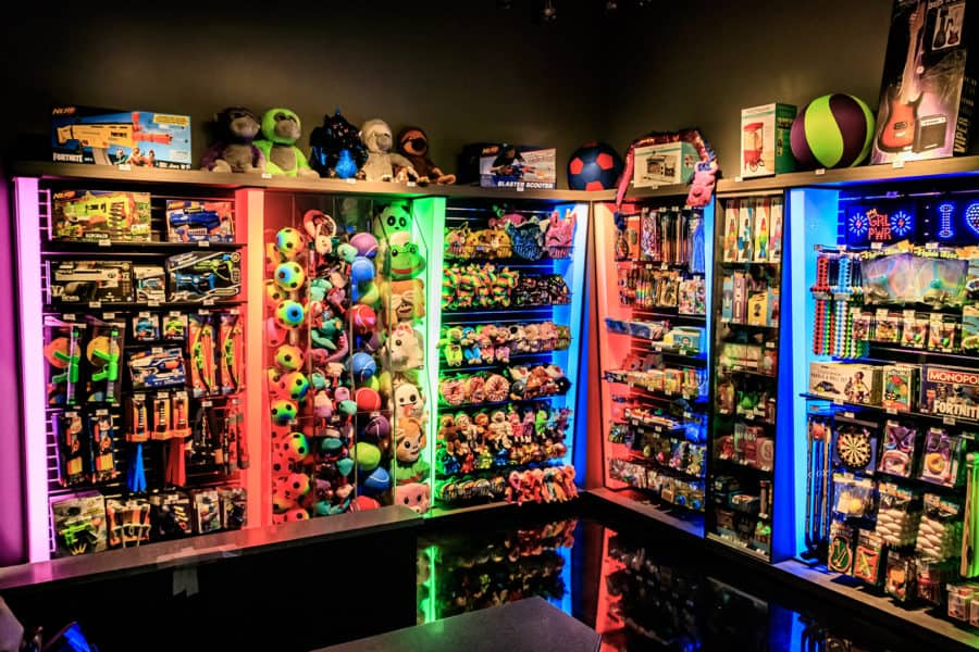 Shelves of Redemption Plus toys at Amusement Expo 2020