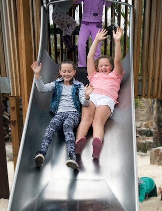 Children on a slide at Natures Playground at Adelaide Zoo