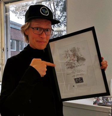 Raine Kajastila, CEO of Valo Motion, with certificate after donating for ancient Finnish forests