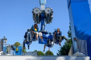 Riders on Booster Unhinged ride entertainment