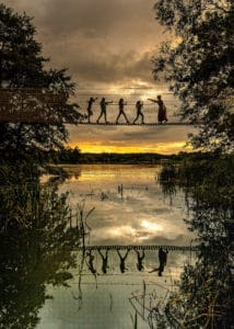 silhouettes of children on a rope bridge at the Skelf Island playground, Castle Howard, Yorkshire