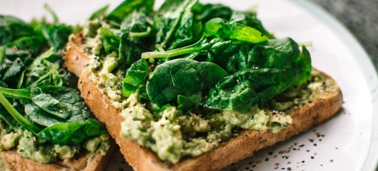 avocado and basil on toast, illustrating the vegan trends