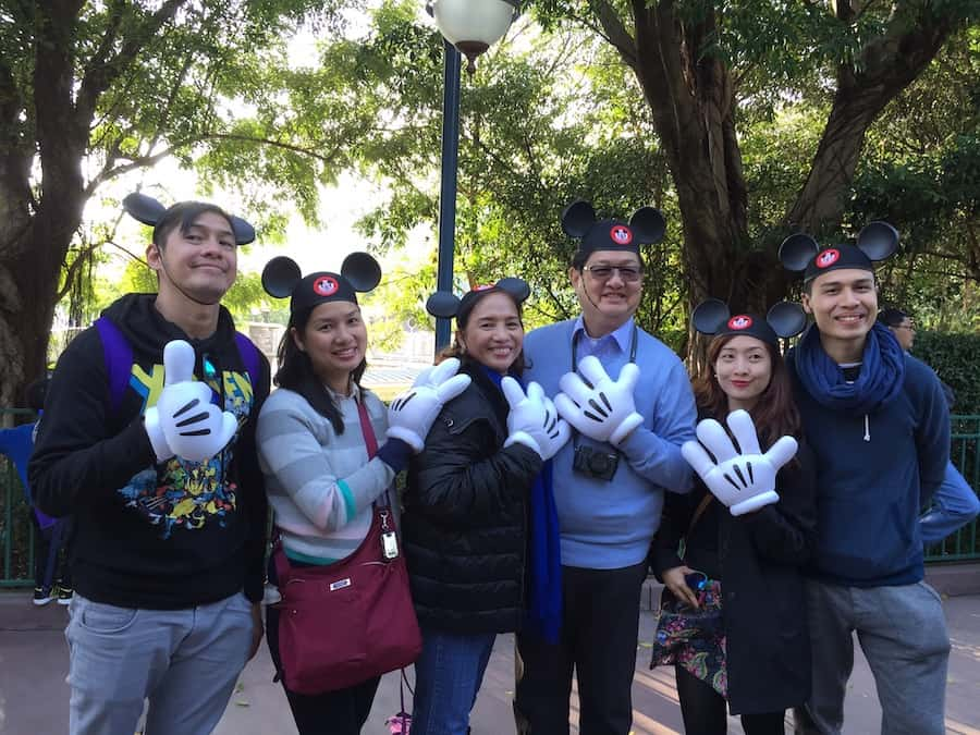 The Mario family enjoys a busman's holiday at Hong Kong Disneyland. Left to right_ Raymond, Anna, Cynthia, Mario, Bea and Nico.