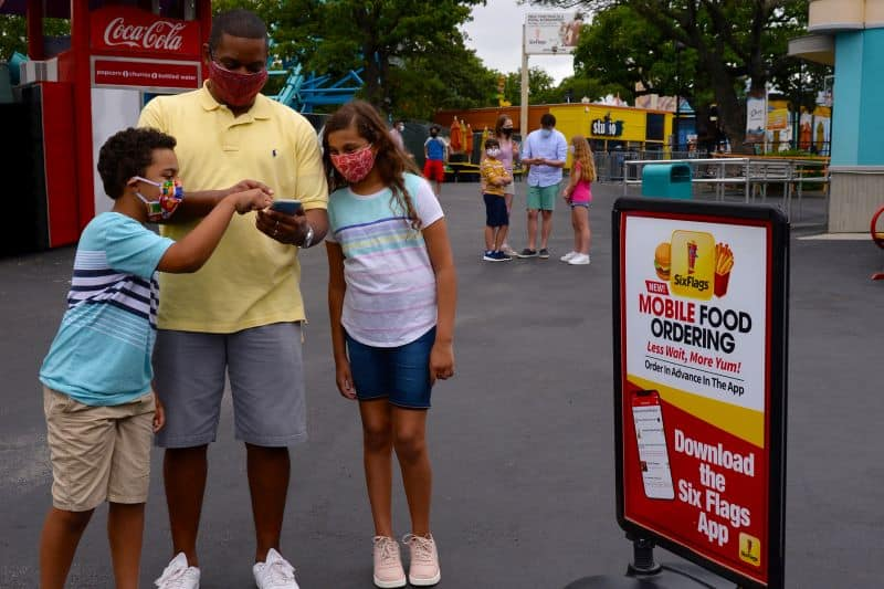 Guests using the Six Flags mobile ordering app US attractions COVID 19