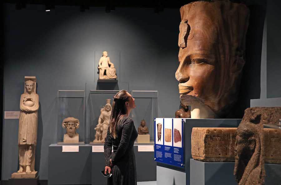 woman looking at ancient egyptian statue liverpool