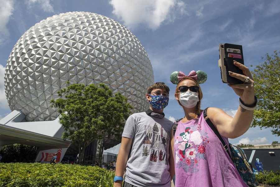 theme parks coronavirus guests wearing masks at Epcot Disney