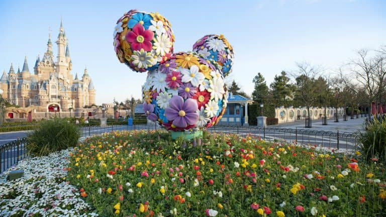Shanghai Disneyland castle with flowers in front