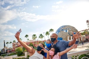 theme parks coronavirus family at Universal Orlando in masks
