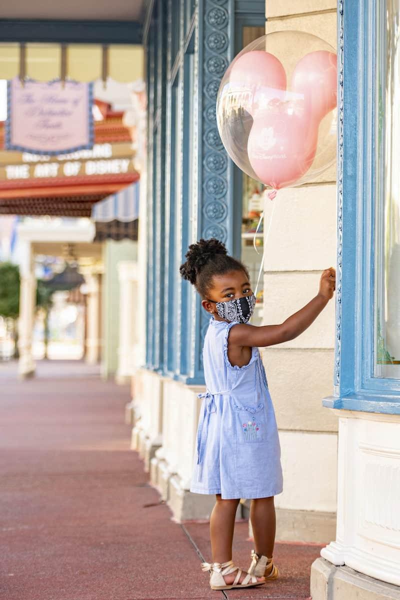 girl with mask at Walt Disney World