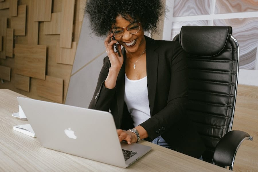 woman making phone call in office achieving operational excellence Shaun McKeogh