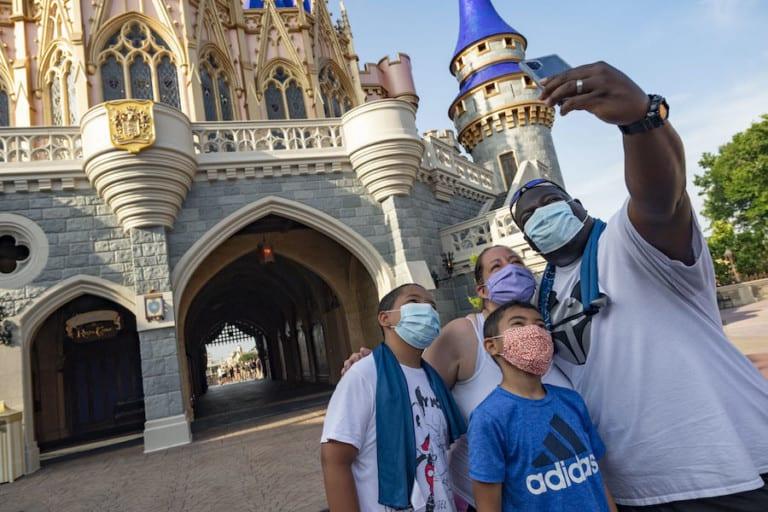 Family at Disney World masks
