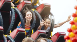 Young friends on roller coaster ride.