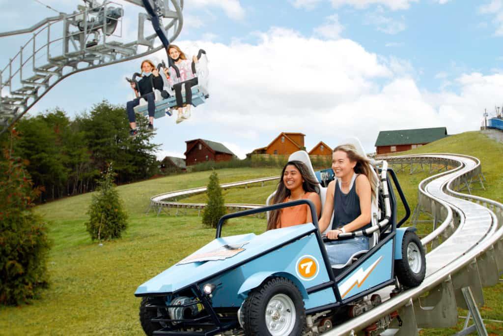 Two young women enjoy the Wiegand CoasterKart ride at Rowdy Bear Ridge Adventure Park