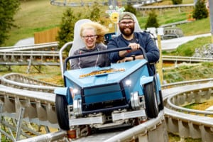 Two riders on the Wiegand CoasterKart ride at Rowdy Bear Ridge Adventure Park