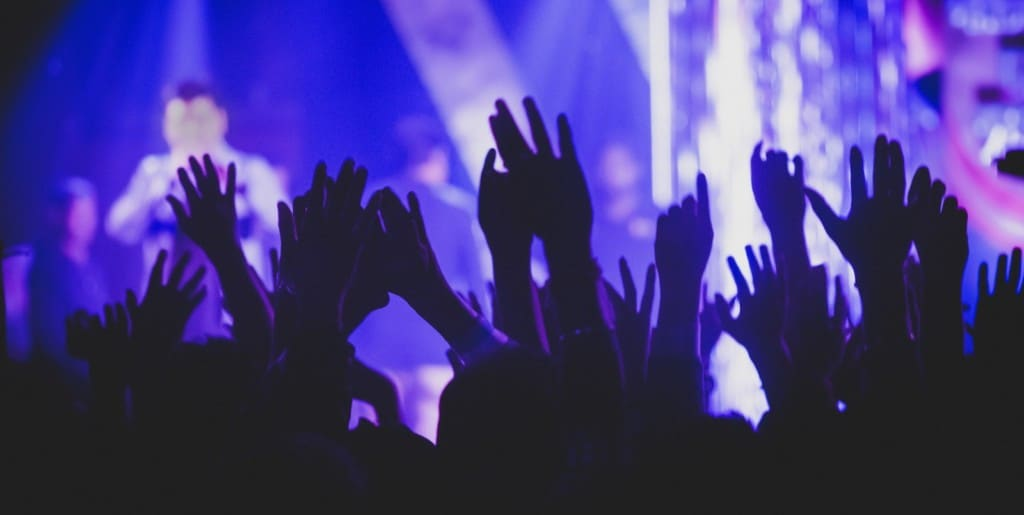 live events set to bounce back post covid - crowd silhouette at concert