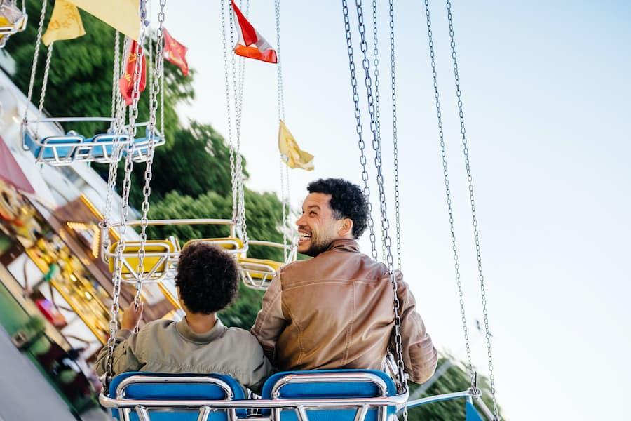 Father-Son-on-theme-park-ride convious platform