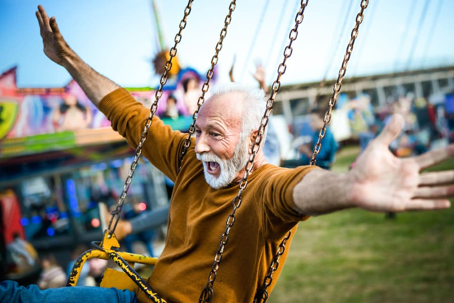 grandfather-on-ride-at-amusement-park