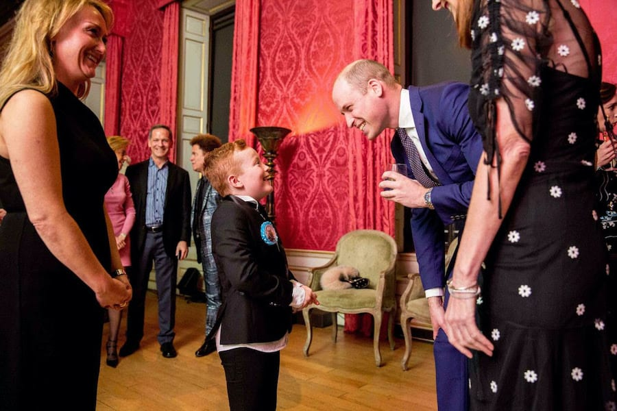 Prince William meets a young fan at a BAFTA event