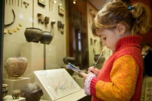 young girl at museum with exhibits