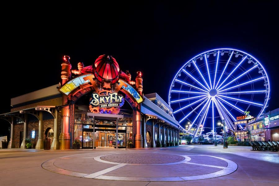SkyFly attraction at night